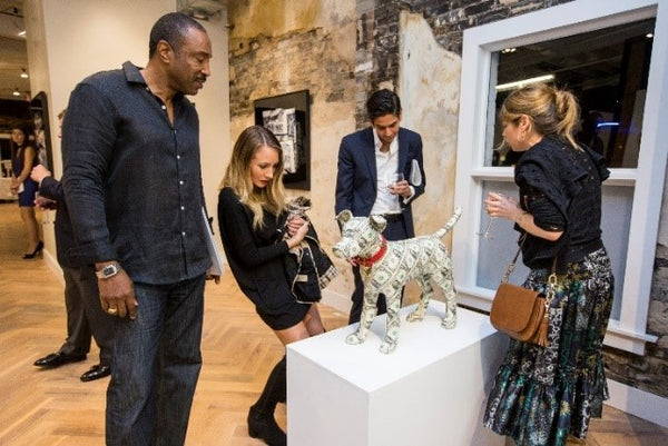 The artist, Justine Smith, engaging with clients at Art & Currency - A Reinterpretation of Cash and Coins.