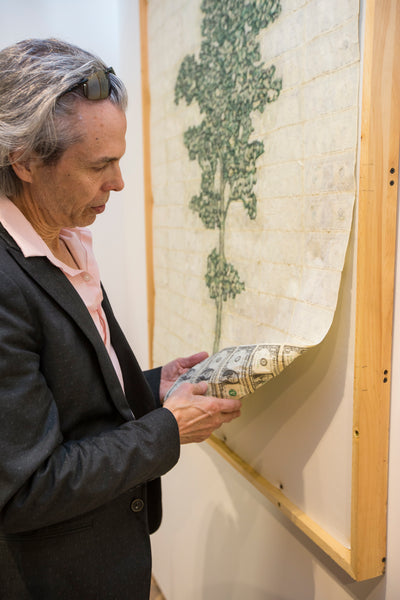 Artist Robin Clark showing the reverse side of One Tree Cannot Make a Forest 02