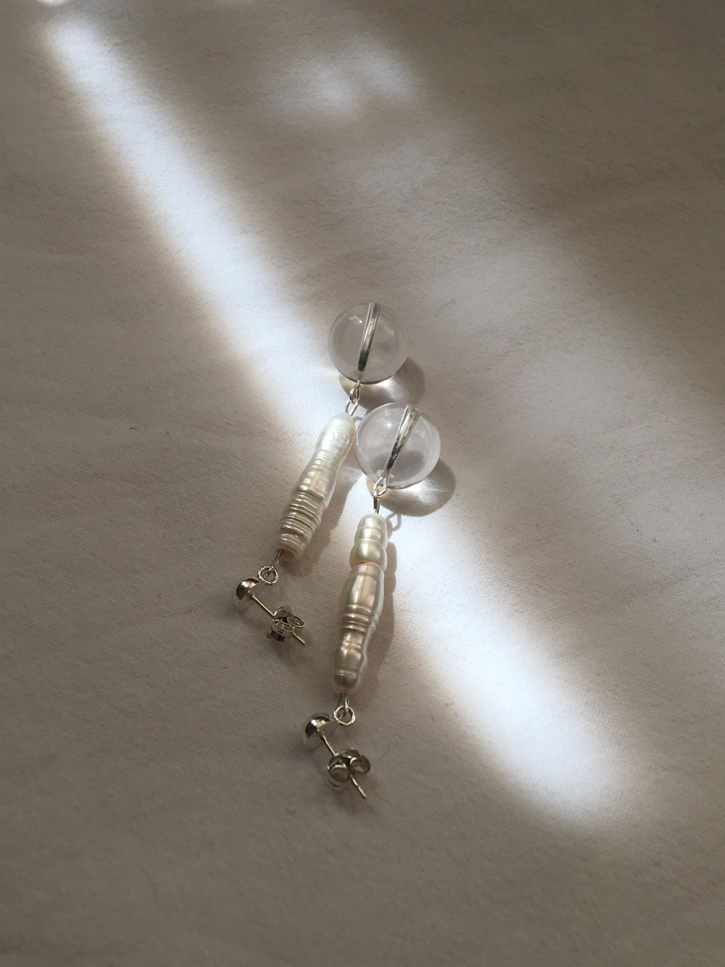 Handmade earrings with 925 sterling silver, freshwater pearls and crystal quartz