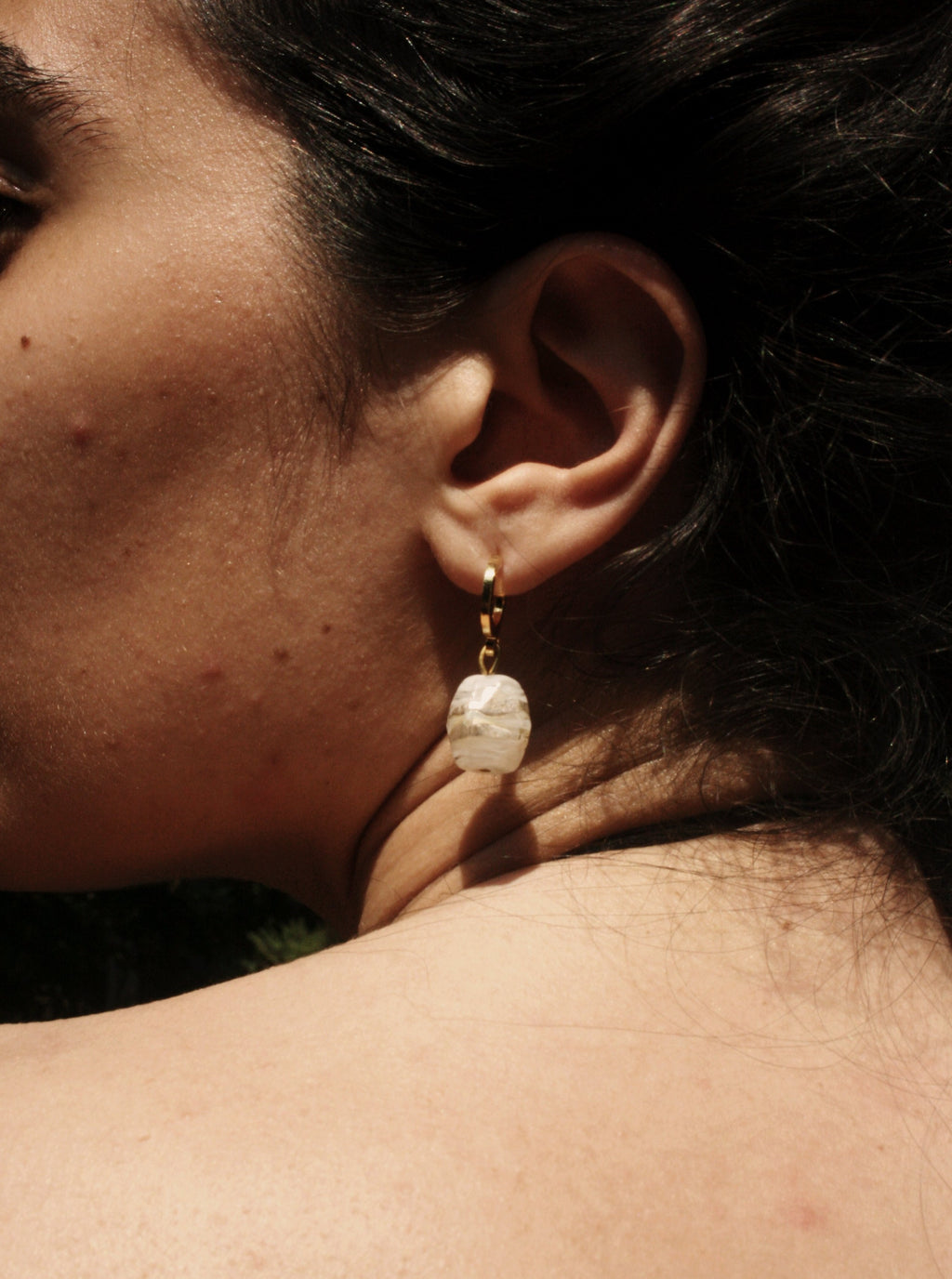 Handmade earrings with gold-plated brass half hoops and gilded molten glass beads