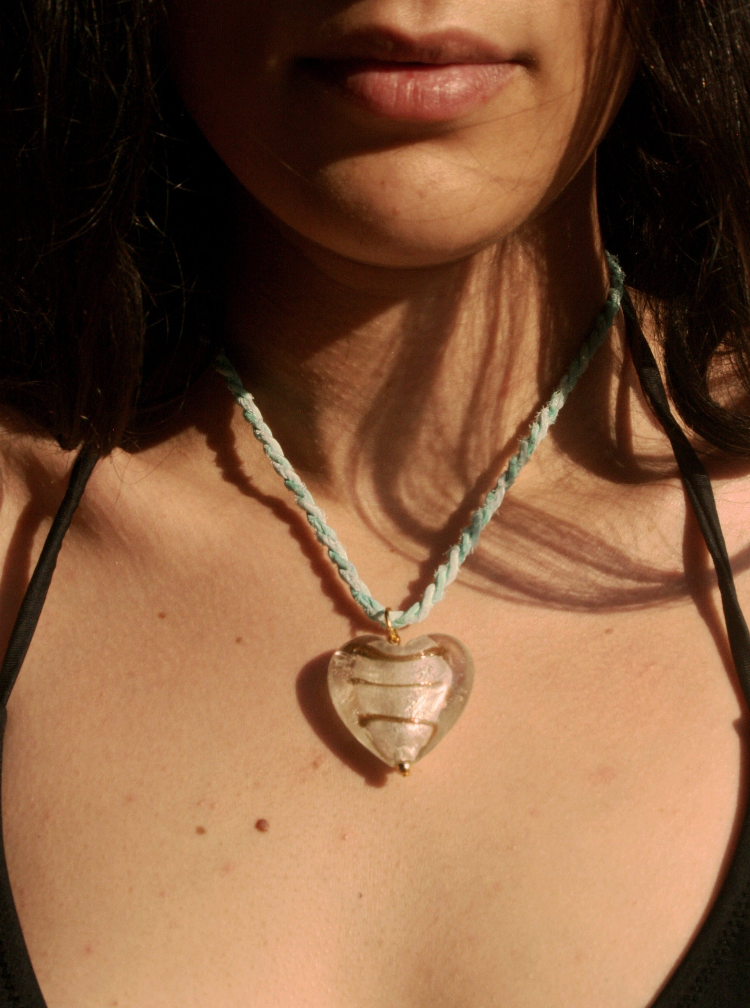 Necklace with a heartshaped glass pendant on a turquoise silk rope. Handmade to order.