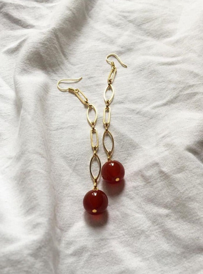 Handmade earrings in red agate and gold-plated brass