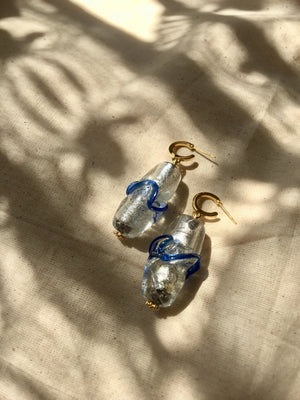 Handmade blue and silver Murano glass earrings with gold-plated hooks. Statement jewelry.