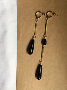 Handmade earrings with gold-plated brass bars, half-hoops and drop-shaped onyx beads. Long, short, or asymmetrical. Statement jewelry.