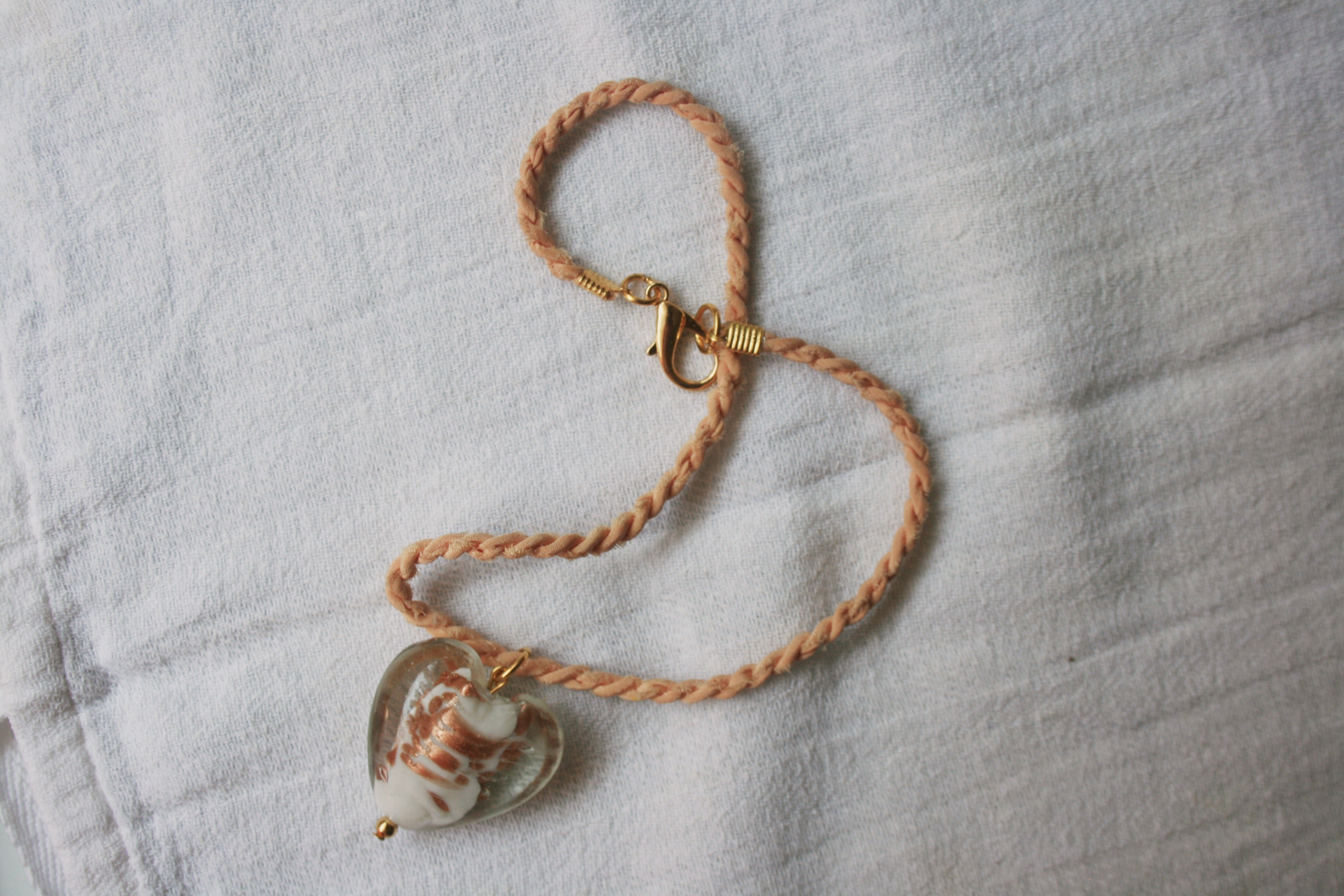 Necklace handmade in a powder pink silk rope and a heart shaped Murano glass pendant bead