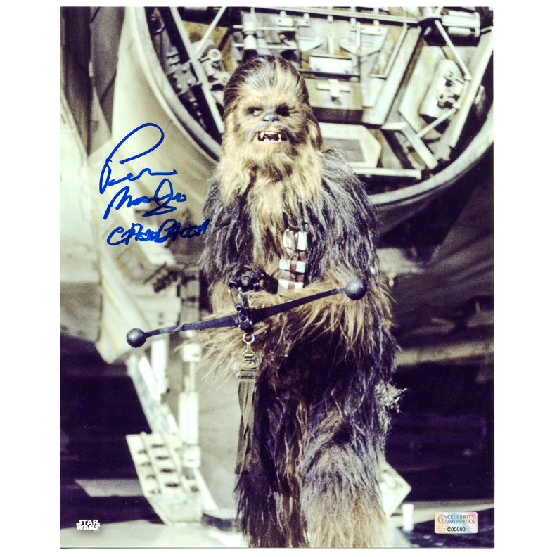 Peter Mayhew Autographed Star Wars: A New Hope Chewbacca Bowcaster 8×10 Photo