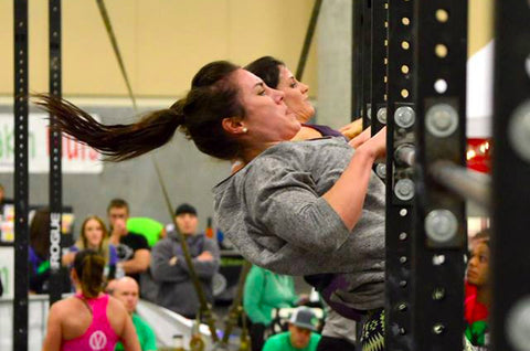Emily Beers doing chest to bar pull-ups at a CrossFit competition