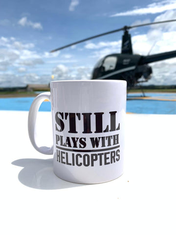 Caneca Still plays with helicopters