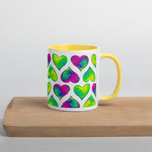 Load image into Gallery viewer, Yellow mug Psychedelic hearts on a wooden plate
