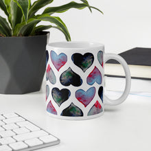 Load image into Gallery viewer, Mug with watercolor hearts on an office table