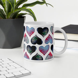 Mug with watercolor hearts on an office table