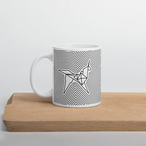 Mug with the art paper-folded unicorn on a wood board