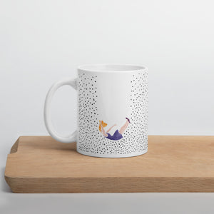 Mug falling lady on a wooden board