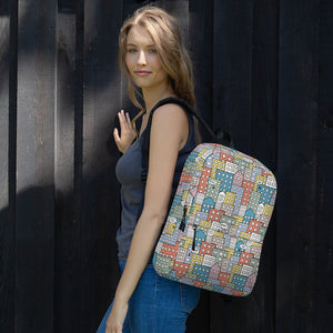 Girl wearing the backpack wishes in the buildings by Varanda Design