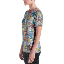 Load image into Gallery viewer, Model wearing the short sleeve t-shirt wishes in the city by Varanda Design - left