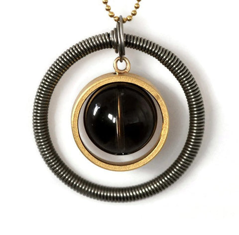 Smoky Planet - Smoky Quartz in a golden ring in a stainless steel spring ring - Gal Barash - long big Pendant