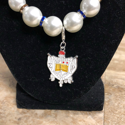 SGRho Pearl Necklace with Shield Charm
