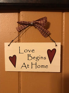 "Rustic ""Love Begins at Home"" sign hanging home decor"