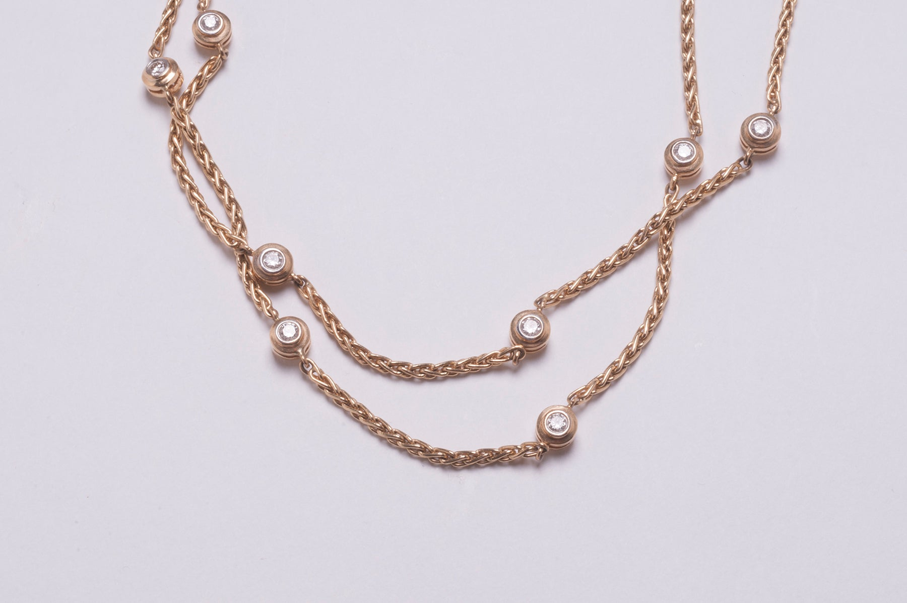 DOUBLE-FACED DIAMOND CHAIN IN 18 KARAT YELLOW GOLD