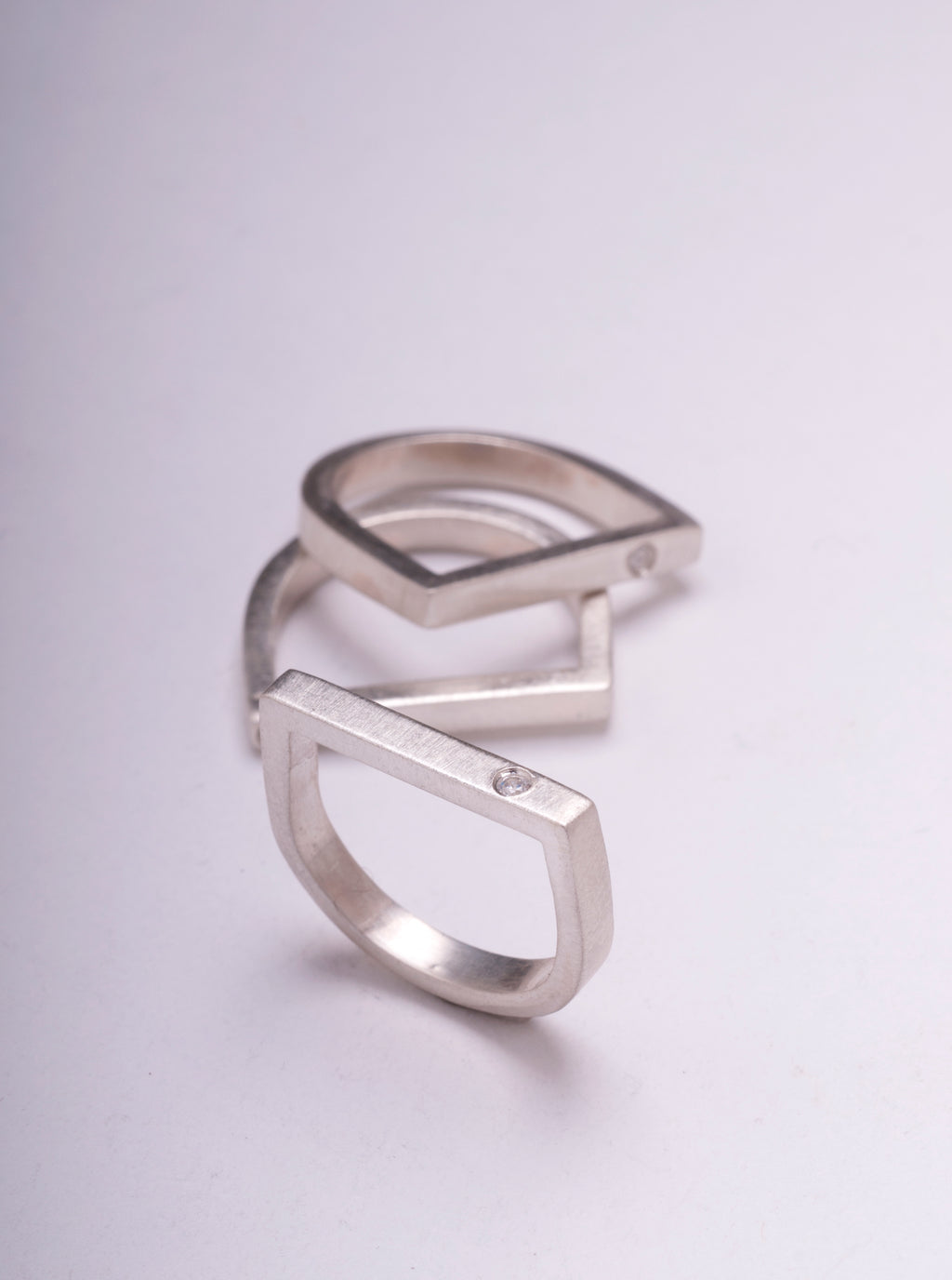 D SHAPE STACK RING WITH WHITE TOPAZ