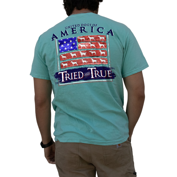 Printed on a Comfort Color chalky mint colored t-shirt the united dogs of America design is a wooden version of the United States flag. With the red strips would be, are pieces of wood with white silhouttes of different species of hunting dog.