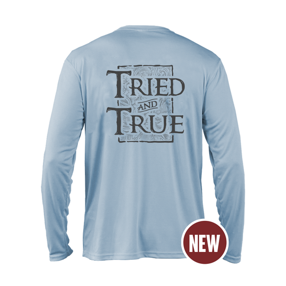 Baby blue T&T original performance/fishing garment with three sublimated prints: left chest, left sleeve, and back. The left chest is a two town grey,