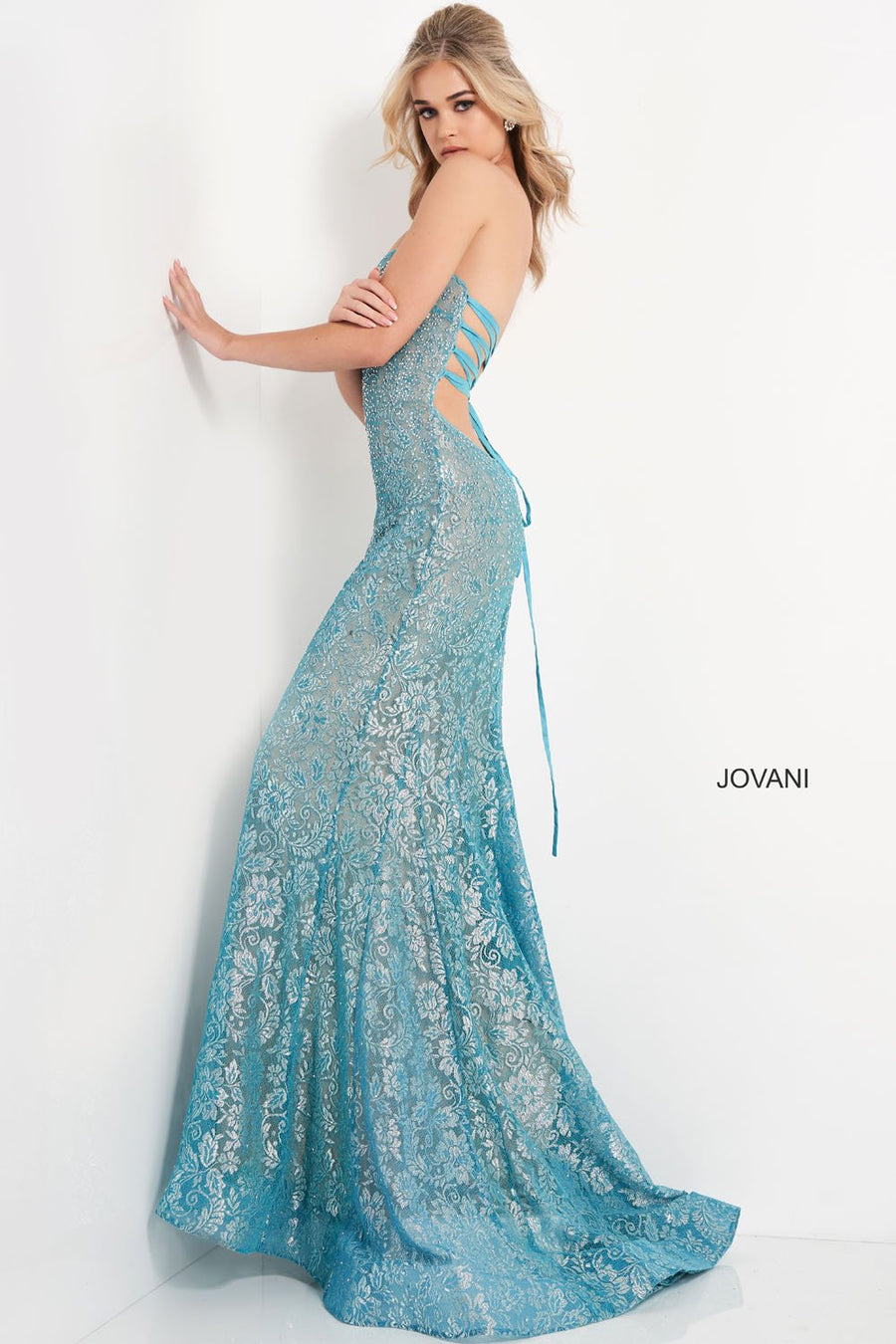 Jovani 06586 prom dress images.  Jovani 06586 is available in these colors: Turquoise Silver, Silver Silver, Black Silver, Navy Silver.
