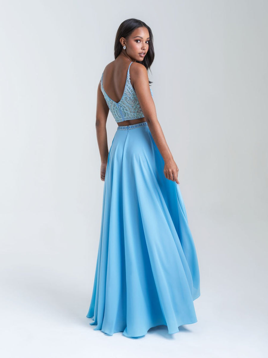 Madison James 20-389 prom dress images.  Madison James 20-389 is available in these colors: Sky Blue, Mint, Fuchsia, Black.