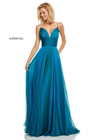 Sherri Hill 52590 prom dress images.  Sherri Hill 52590 is available in these colors: Peacock, Navy, Yellow, Teal, Burgundy, Eggplant, Gunmetal.
