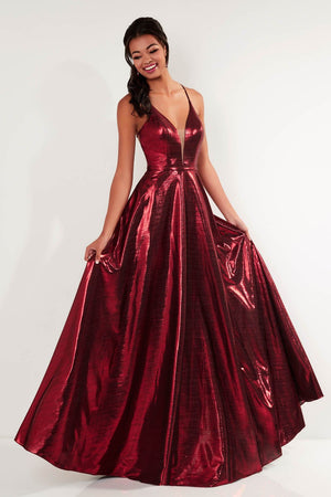 Studio 17 12736 prom dress images.  Studio 17 12736 is available in these colors: Bronze, Midnight, Wine.