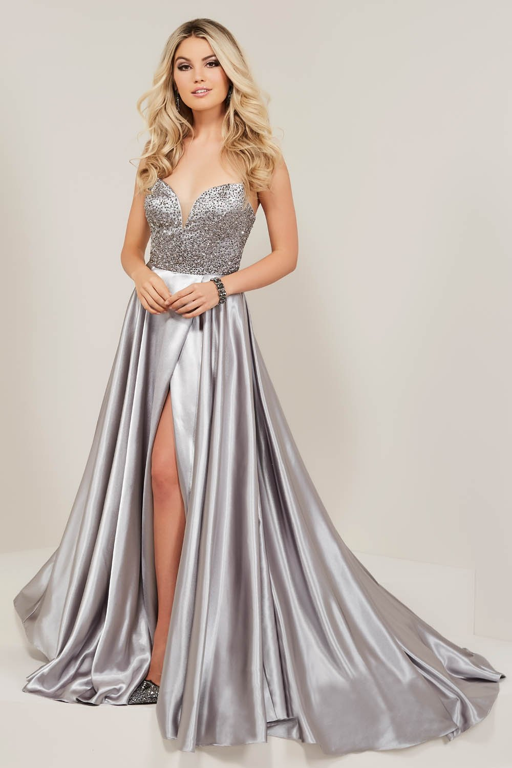 Tiffany 16341 prom dress images.  Tiffany 16341 is available in these colors: Black, Emerald, Gunmetal.