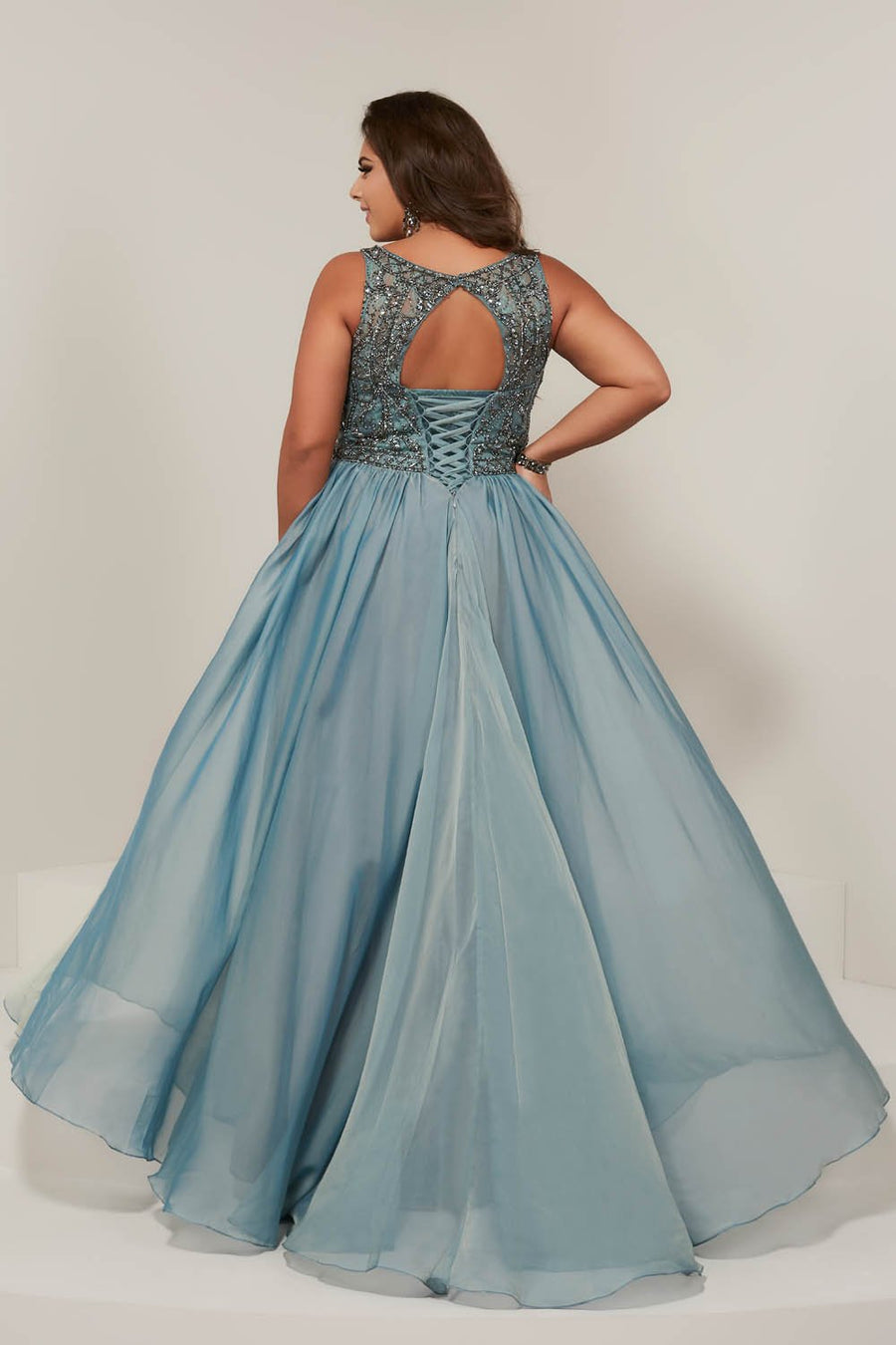Tiffany 16379 prom dress images.  Tiffany 16379 is available in these colors: Sage, Sangria.