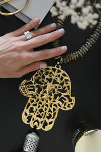 Gold plated Hamsa with Dalmatian Jasper stones.