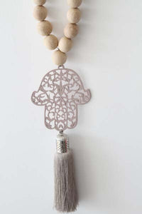 Boho style wood beads strung with light pink Hamsa