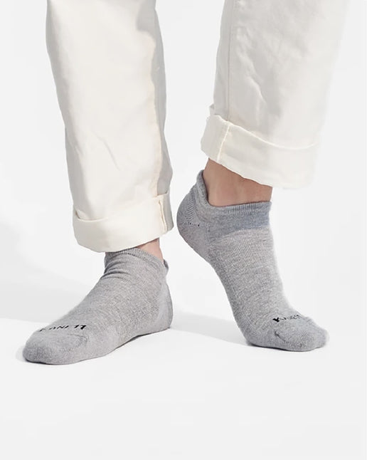 White pants and grey ankle socks on white background.