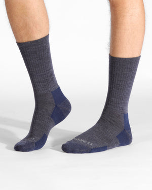 mens heather blue sock, crew height, on feet.