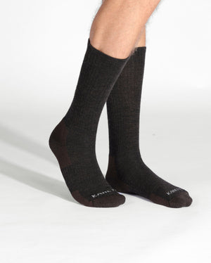 mens heather brown sock, crew height, on feet.