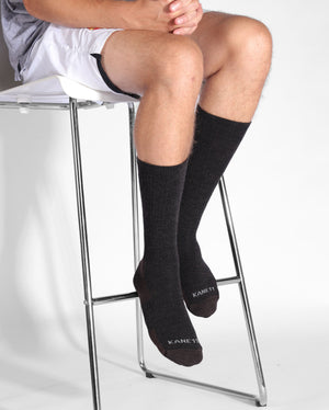 mens heather brown sock, crew height, lifestyle image.