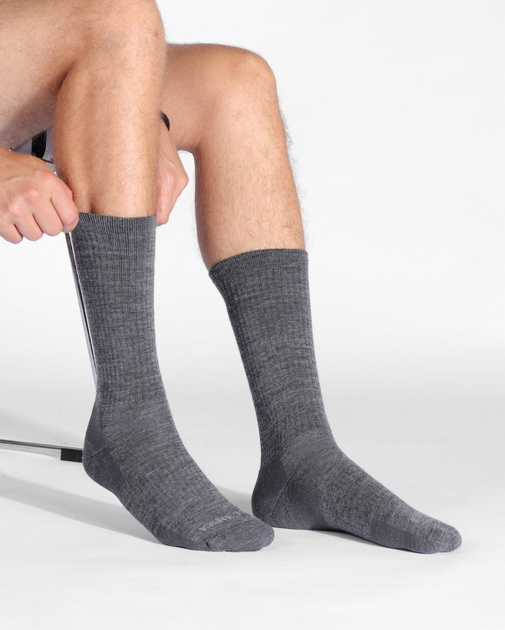 mens heather grey sock, crew height, lifestyle image.