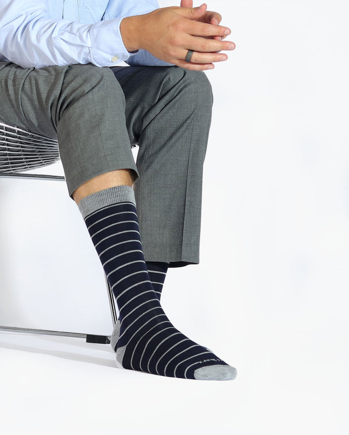 Mens navy sock with big grey stripes, crew height, lifestyle image.