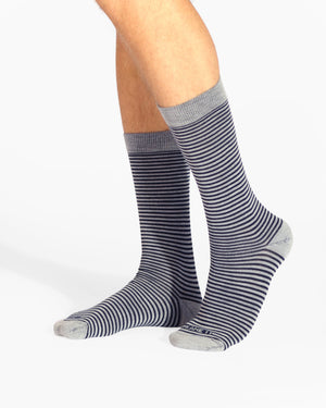 Mens grey sock with small navy stripes, crew height, on feet.