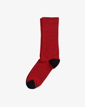 Mens crew sock in red with black toe and heel caps. laid flat.