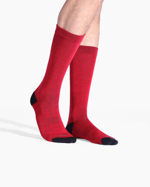 Mens crew sock in red with black toe and heel caps. on feet.