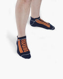 mens ankle sock in navy with neon orange on feet
