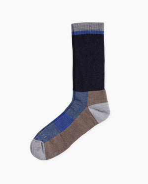 Mens wool crew sock in: navy with brown and blue. Laid flat.