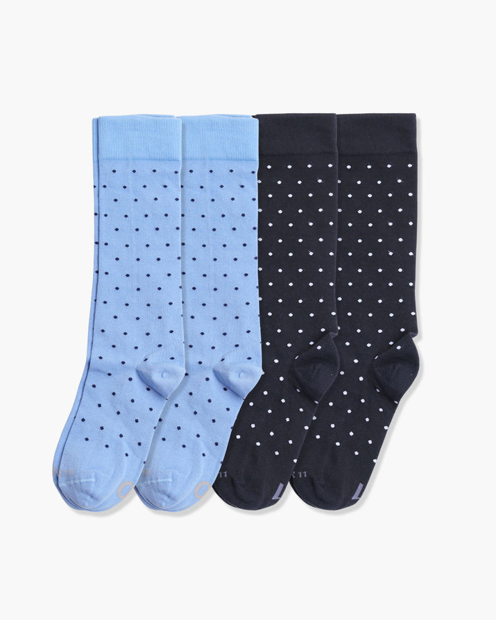 Mens 4 pack of crew socks. Two pairs of light blue with navy dots and two pairs of black with grey dots.