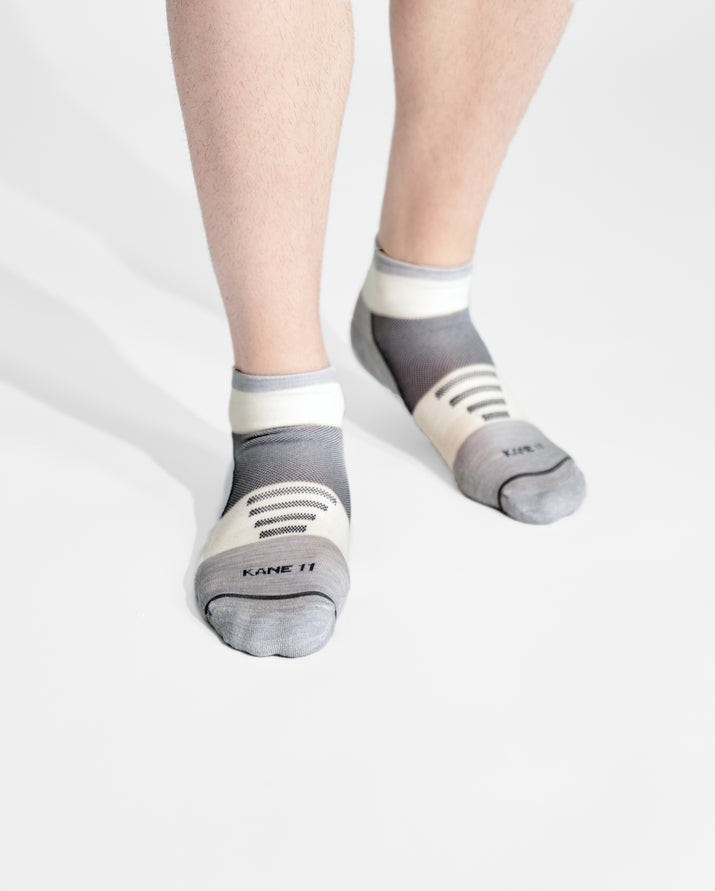 mens quarter sock in grey with ivory on feet