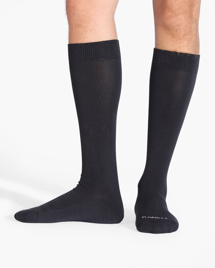 Mens over the calf sock in charcoal grey, on feet.