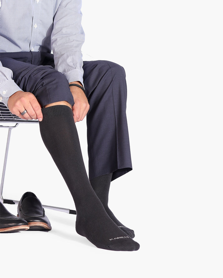 Mens over the calf sock in charcoal grey, lifestyle.