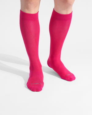 mens knee high sock in hot pink on feet